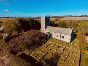 Holcombe Burnell Church from the air on a glorious summer day