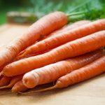 Fresh carrots on a chopping board