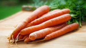 Fresh carrots on a chopping board