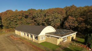 Village Hall from the air with some solar panels.