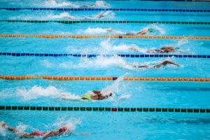 Competitors swimming